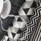 chevron, ongelijke streep, triangel strak, spetterstreepjes katoen zwart wit met zachte platte elastiek op rol