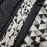 zwart wit kleine ster - geo triangels wit zwart - uni zwart laken - triangels strak katoentjes